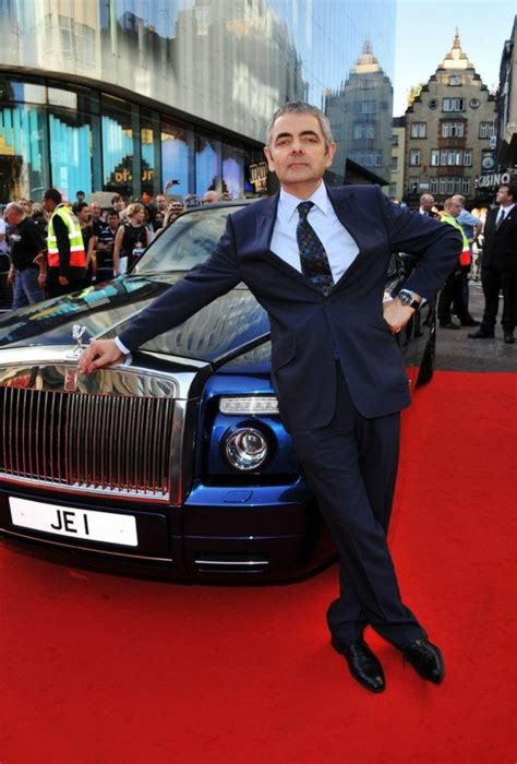Rowan Atkinson poses by the one-off Rolls-Royce V16