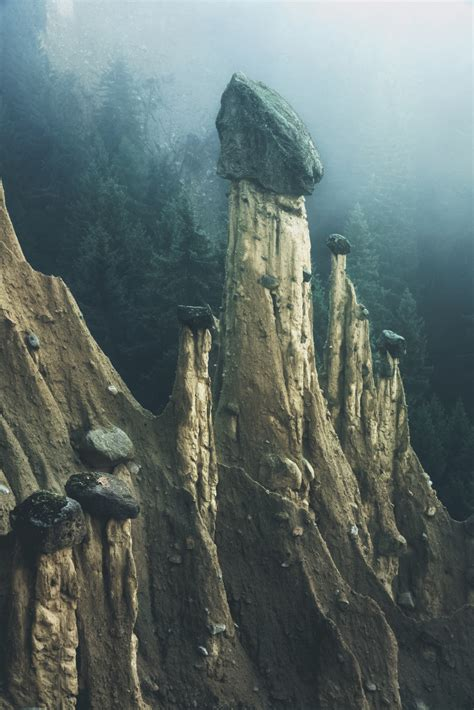 Otherworldly 'Earth Pyramids' Captured in the Foggy Early
